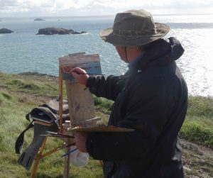 Jon painting near Caerfai